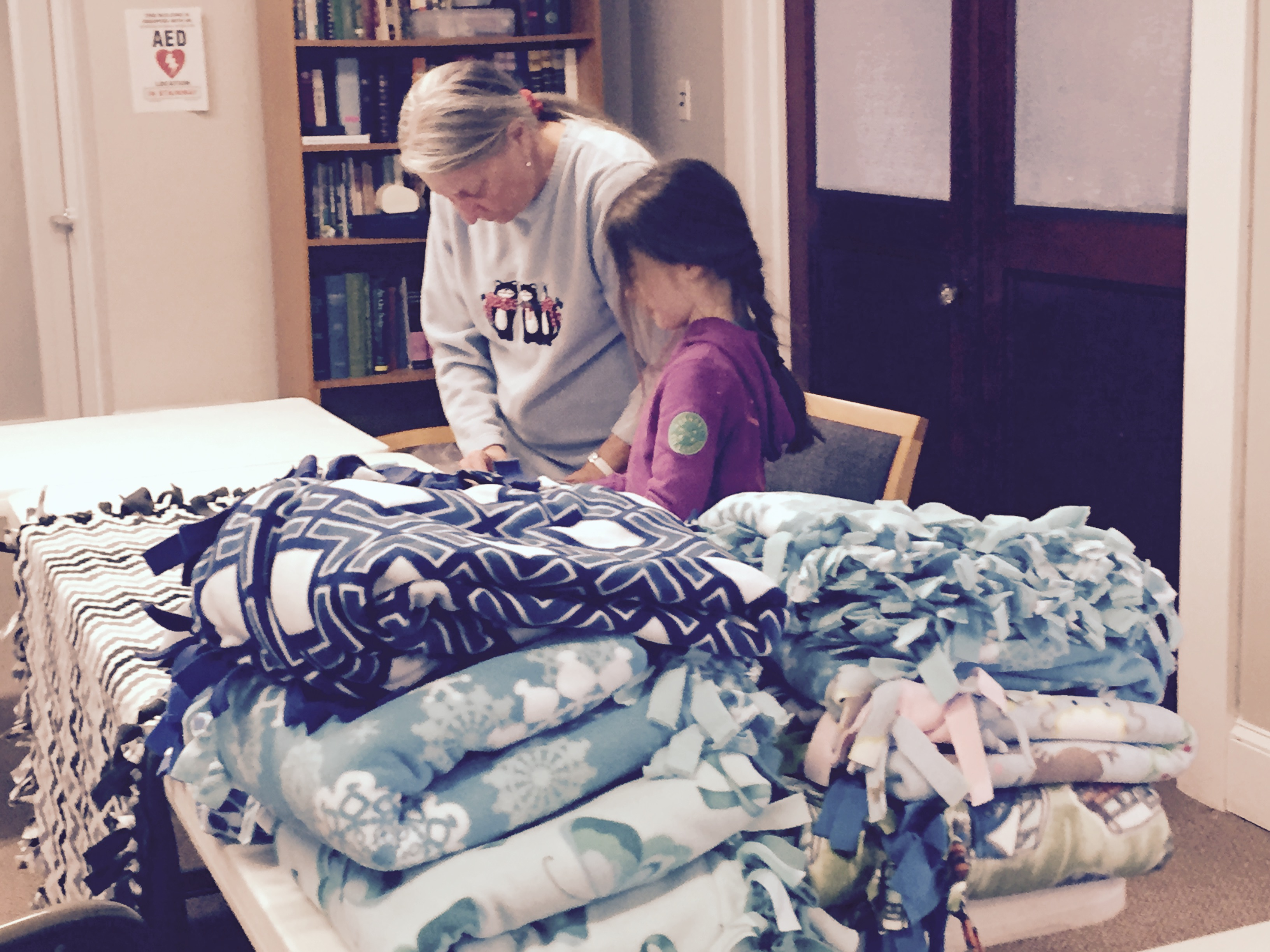 Volunteers prepare the blankets for delivery to those in need.